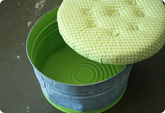 Upholstered Bucket Ottoman | I love this idea for turning a metal bucket into a storage ottoman! This is perfect for storing toys in a nursery or playroom!