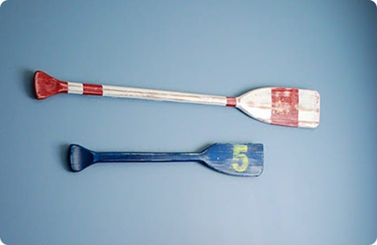 painted and distressed oars