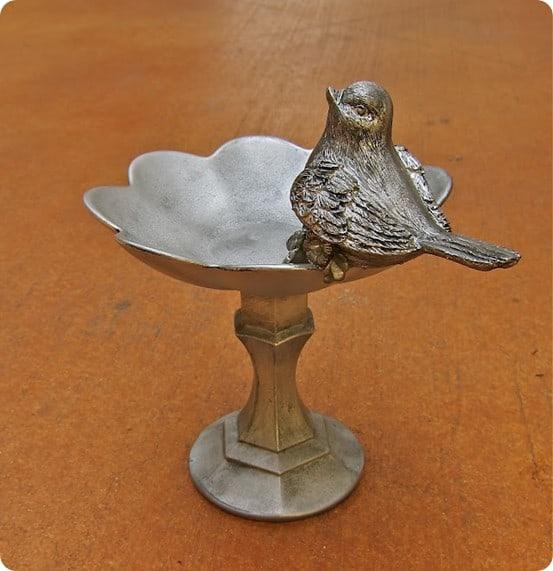 faux silver bird pedestal