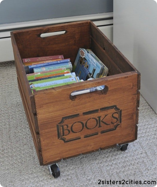 DIY Storage Ideas | Stain an unfinished wood crate, add casters, and stencil the side to make adorable toy storage!