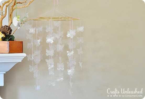 DIY Home Decor ~ How pretty is this Pottery Barn knock off butterfly mobile that was made with wax paper? Love it!