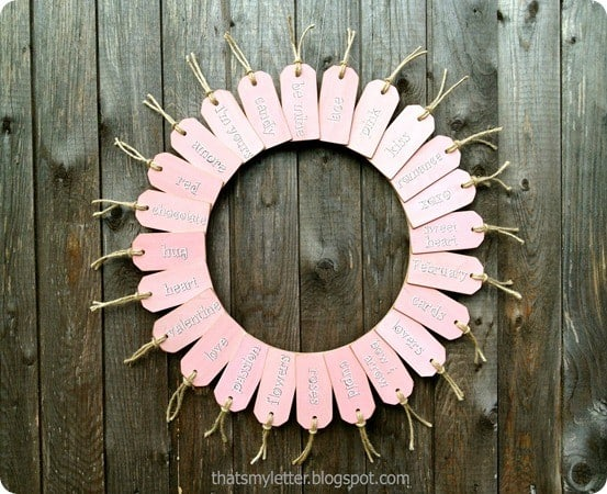 Valentine's Day Crafts ~ I love this adorable Valentine's wreath made from little wood tags. So cute!