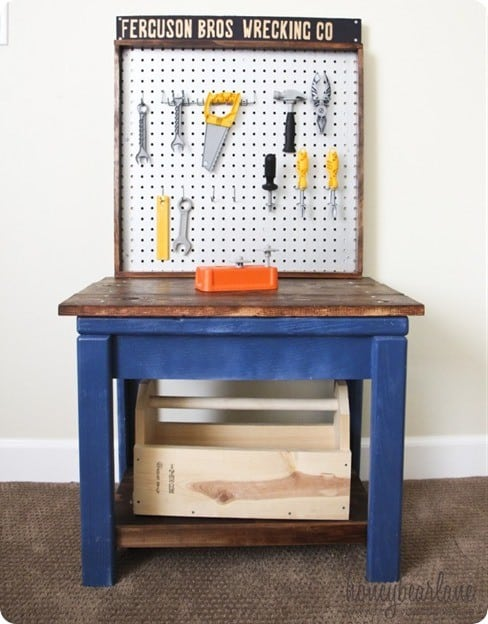 Turn an old side table and piece of pegboard into a kids play workbench!