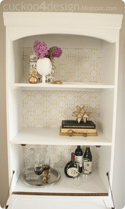 I love this idea for adding interest to the back of a bookcase with a Sharpie. It looks just like wallpaper!