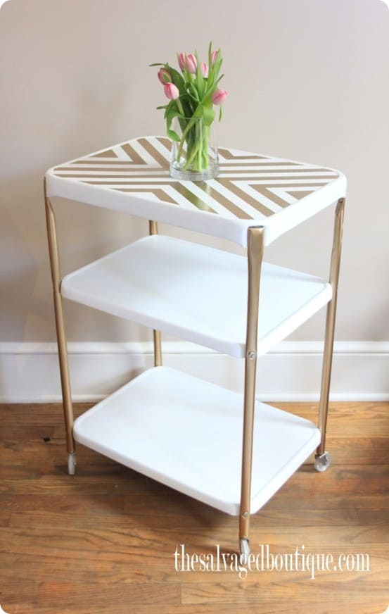 gold and white painted rolling cart