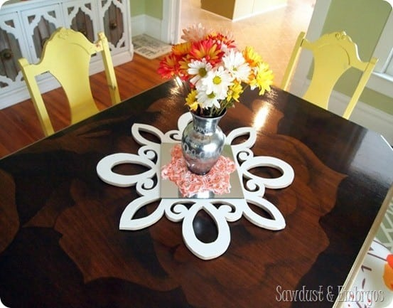 scrolled wall mirror and centerpiece