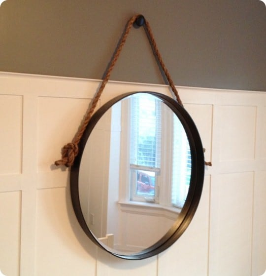 round metal and rope mirror