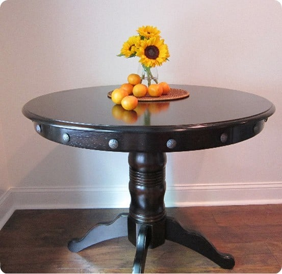 round dining table with nailhead trim