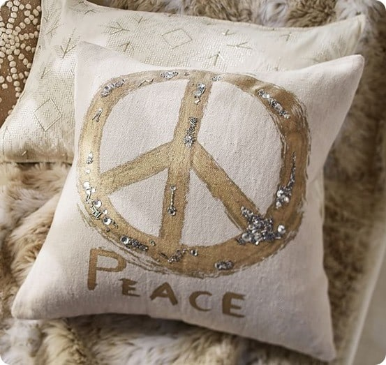 metallic embroidered peace sign pillow cover from pottery barn