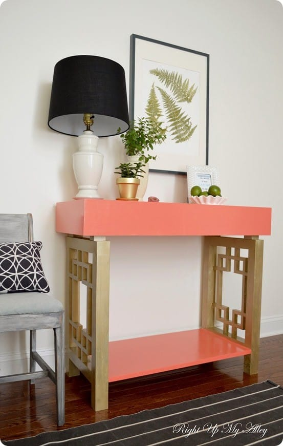 Coral and Gold Fretwork Console Table