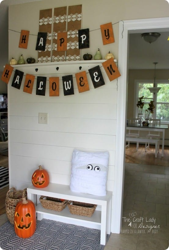 Pottery Barn Knock Off Halloween Entryway ~ This Pottery Barn inspired entryway with a burlap banner and mummy pillow was created using a few items from the craft store!