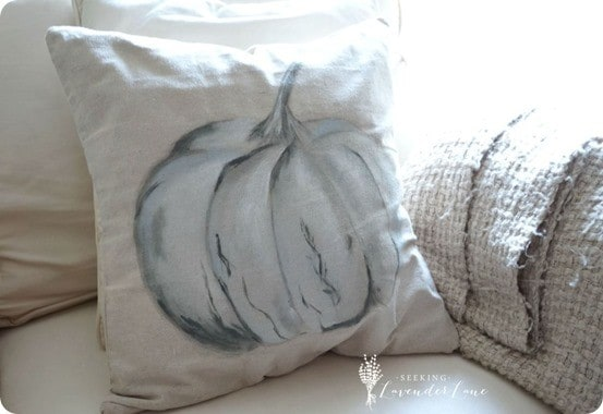 Fall Decorating Ideas | Pottery Barn Knock Off Pumpkin Pillow ~ Fall pillows only sit on your couch a month or two. To save money, paint a cheap cover from the craft store to look like a Pottery Barn pillow!