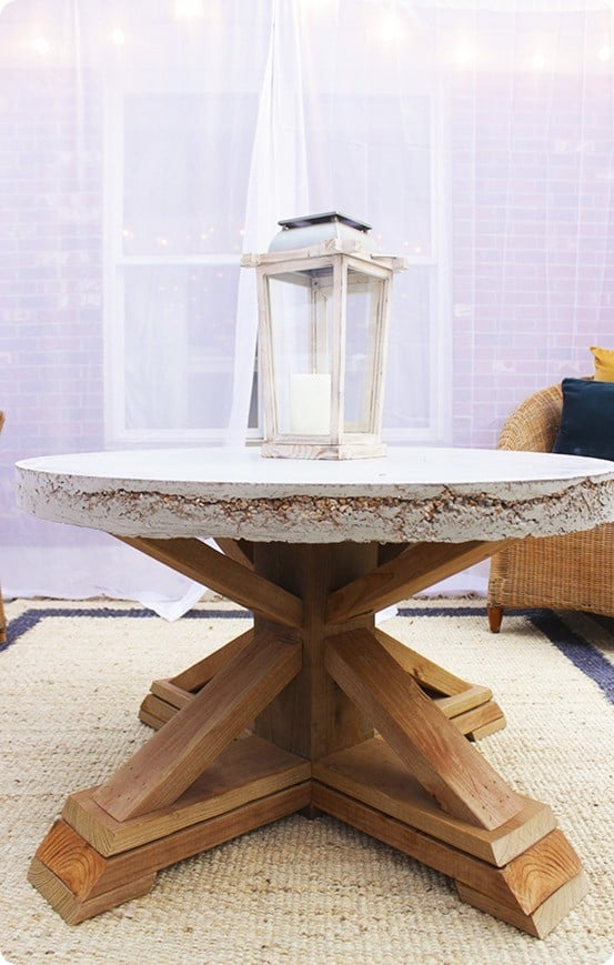 DIY Furniture | X Base Outdoor Coffee Table with Cement Top ~ Get the free building plans to knock off this amazing trestle style coffee table from Pottery Barn!