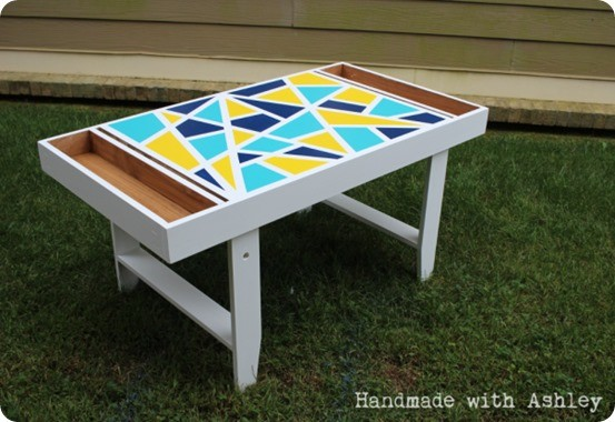 DIY Furniture ~ I love this Pottery Barn Kids knock off art table with a paper roll, built-in storage, and fun geometric design!