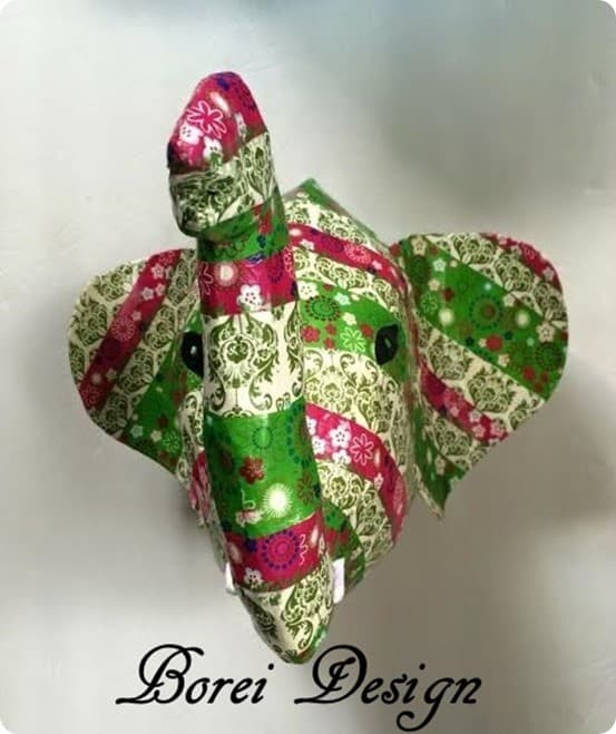 DIY Paper Mache Elephant Bust   Get the step-by-step tutorial and free printable pattern to make this Anthropologie knock off elephant head for $5!