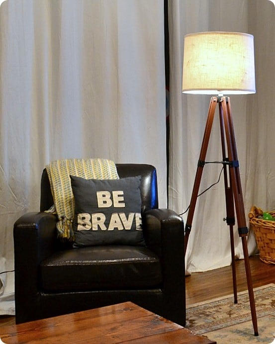 DIY Tripod Lamp | This gorgeous tripod lamp was made using a $4 surveyor's tripod from the thrift store. That's way cheaper than Pottery Barn's $469 price tag!
