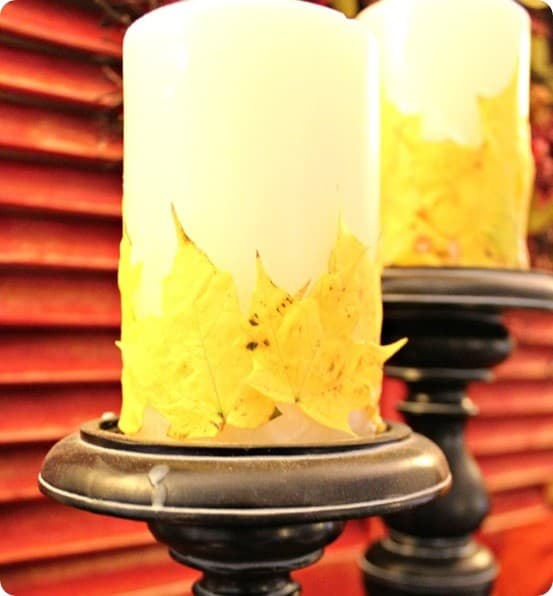 Fall Decorating Ideas ~ Use colorful leaves from your yard to make these pretty Pottery Barn knock off candles for fall!