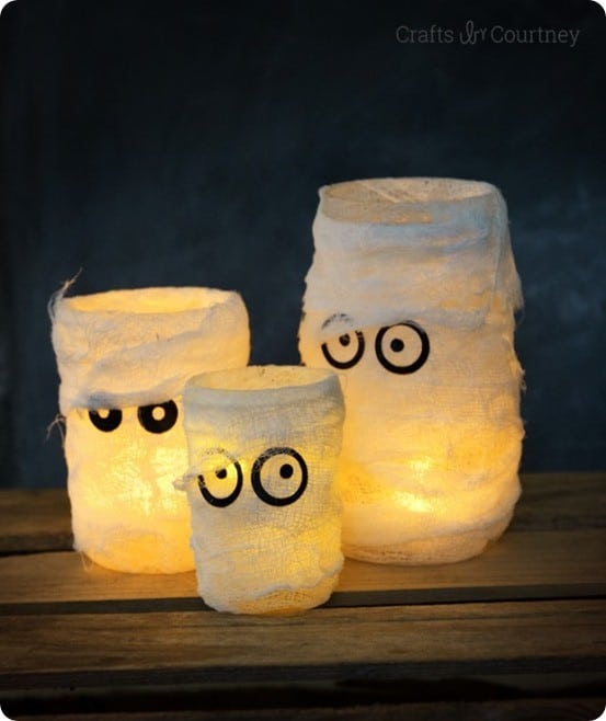 Pottery Barn Knock Off Mummy Luminary ~ Use mason jars or upcycled glass food jars to make these fun luminaries for Halloween. They are easy enough your kids can help too!