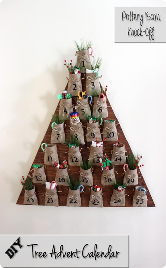 DIY Christmas Countdown ~ Cut a piece of plywood in a tree shape and attach burlap sacks filled with treats or activities. {Pottery Barn Knock Off}