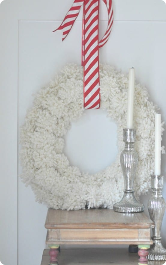 DIY Christmas Decorations ~ This Anthropologie inspired pom-pom wreath is perfect for the holidays and can even remain up for winter!