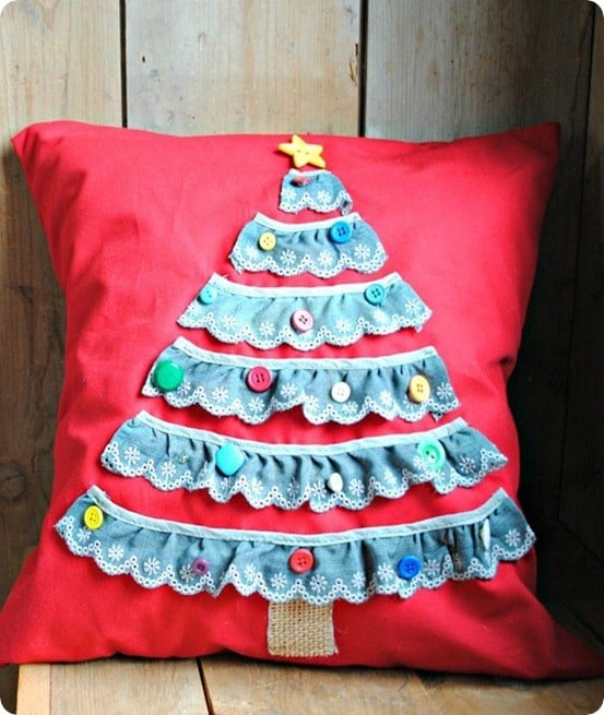"DIY Christmas Decorations ~ This Land of Nod knock off Christmas tree pillow actually has removable buttons so kids can have fun ""trimming the tree!"""