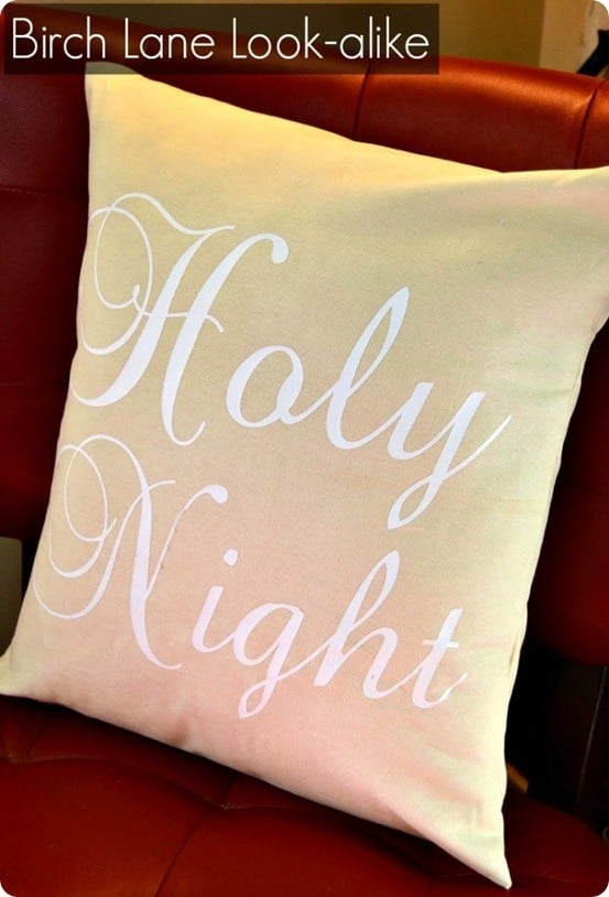 DIY Christmas Pillow ~ Save money on Christmas decor by sewing your own pillow cover from inexpensive fabric and adding iron-on vinyl lettering!