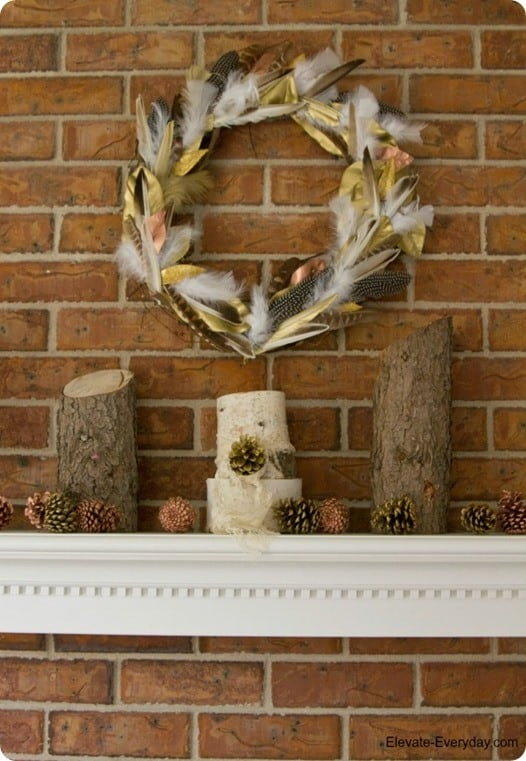 DIY Home Decor ~ Layer feathers and gold and copper painted leaves to make this Anthropologie knock off wreath!