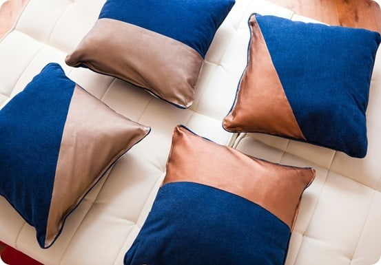 DIY Home Decor ~ Make these designer-inspired leather dipper pillows in five minutes flat using scissors and a hot glue gun!