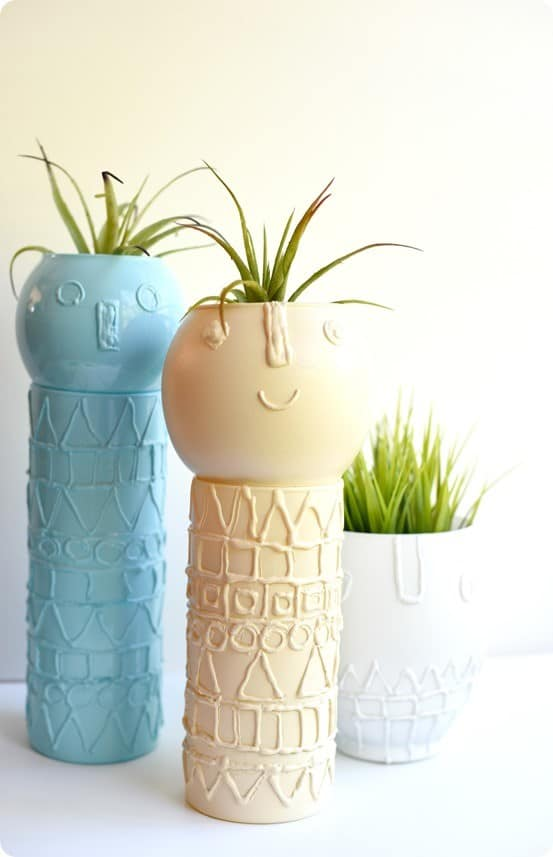 DIY Home Decor ~ Use a hot glue gun to draw designs on glass bowls and vases and then spray paint them for a totally new look. {West Elm knock off}