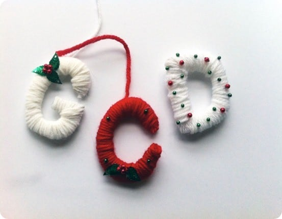 DIY Christmas Crafts ~ You need just cardboard and yarn to make these Anthropologie knock off monogram gift tags. So cute!