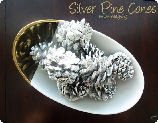DIY Christmas Decorations ~ Grab some pinecones from your yard and a can of silver spray paint to make this West Elm knock off!
