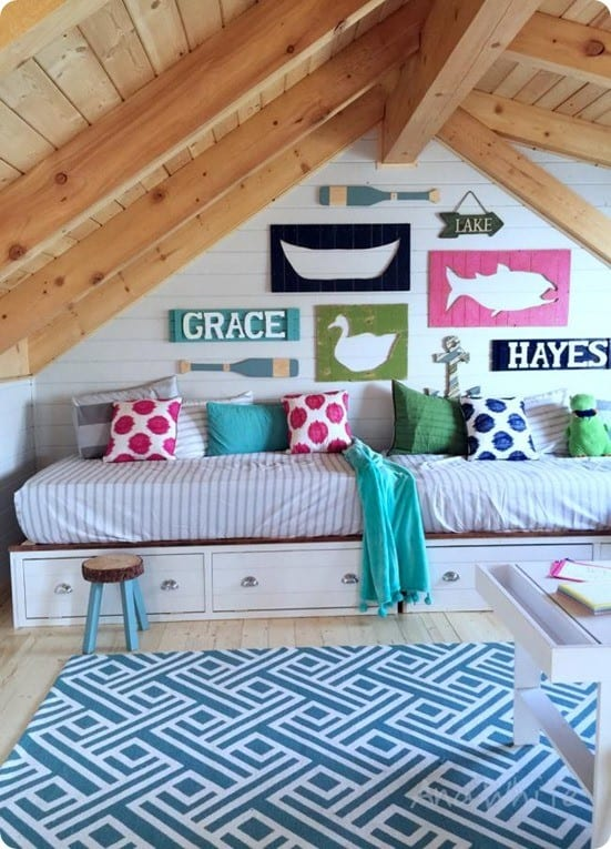 DIY Ideas ~ This amazing cabin space was inspired by Pottery Barn Kids and pulled together through DIY. Get the free project plans to build these ridiculously easy daybeds for less than $100!