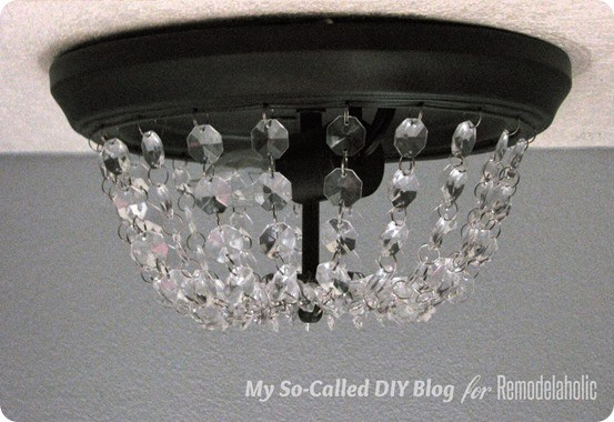 DIY Home Decor ~ Follow this tutorial to turn the dreaded boob light into a Pottery Barn inspired crystal light fixture!