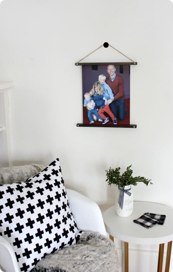 Anthropologie Knock Off Wooden Picture Hanger ~ I love this unique idea for displaying family photos or wall art, and it costs only $5 to make using a square dowel and twine!
