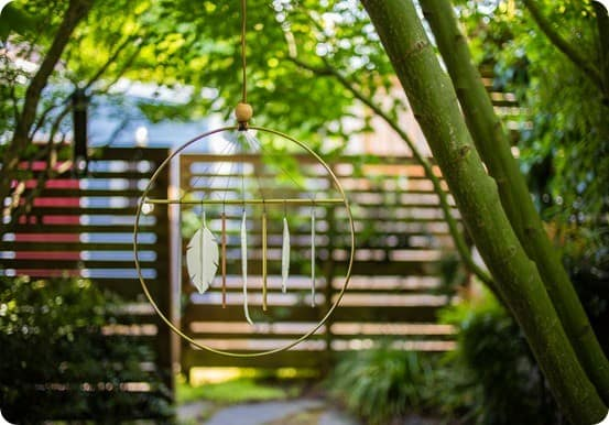 DIY Wind Chimes ~ Make your own pretty chime with a brass embroidery hoop, metal, tubes, and clay shapes!