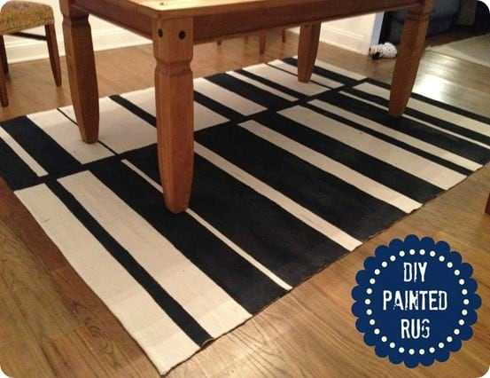 How to Paint a Rug ~ This cheap IKEA rug was painted with offset stripes to look like a pricey rug from CB2!