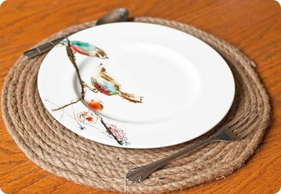 Pottery Barn Knock Off Jute Placemats ~ Grab some rope and a hot glue gun to make these round placemats for your table!