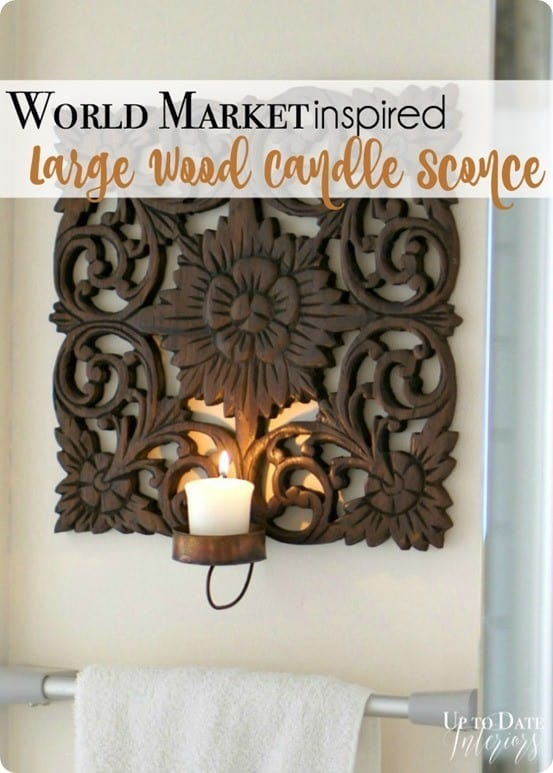 Kathy was inspired by the Carved Wood Peacock Wall Sconce from World Market. & Carved Wood Candle Wall Sconce