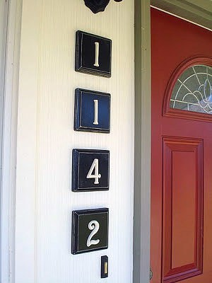 Silver numbers on dark wooden blocks create easy visibility for your guests.