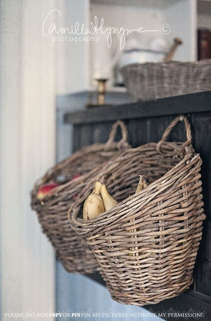 Store your fruit and veggies in a basket on the side of your cabinets.
