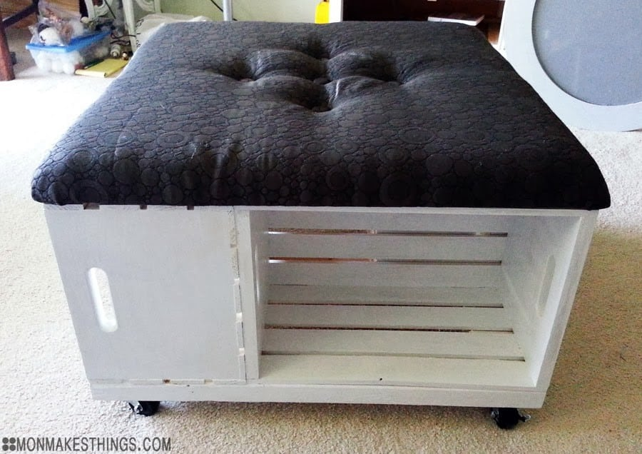 This ottoman offers storage ing the crates and a comfy upholstered top for seating.