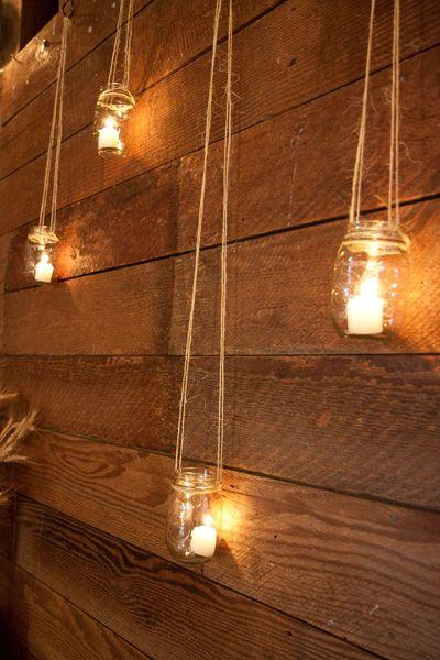 Twine and tealights add just the right amount of dim light near your fence.