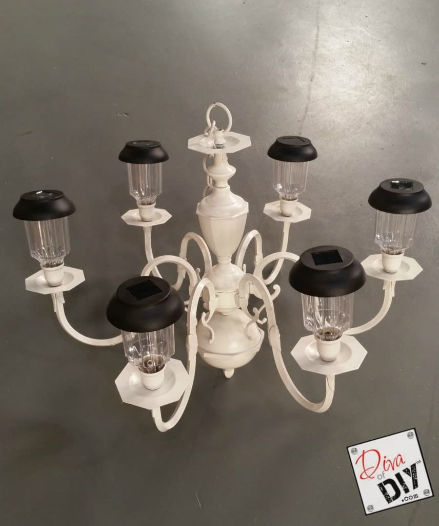 Solar lamps or candles in a chandelier add class to your patio!