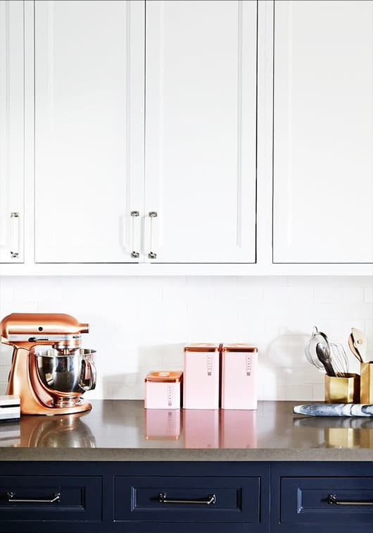 I love how well coordinated the copper and pink are between the counter top appliances and the canisters.