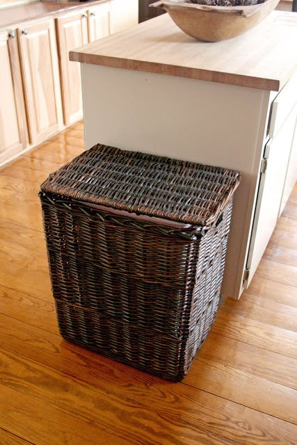 I love the simplicity of a wicker basket to hide a trash can.