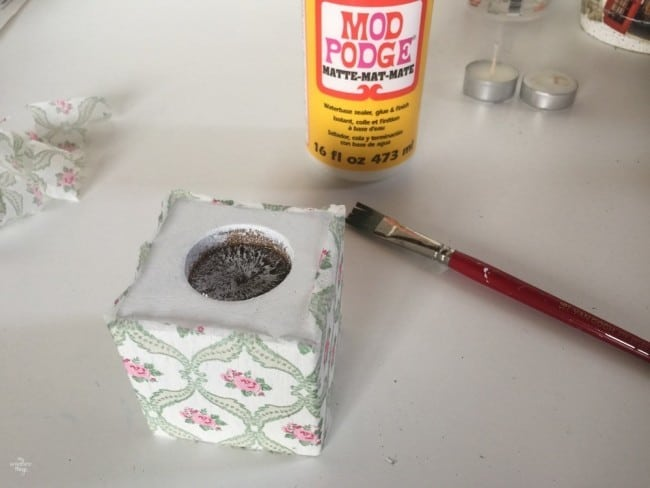 How to to a votive candle holder using paint and napkins - Glueing the napkin with ModPodge