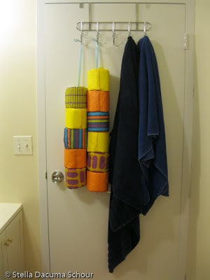 Hanging toilet paper behind your door is perfect for a small bathroom.