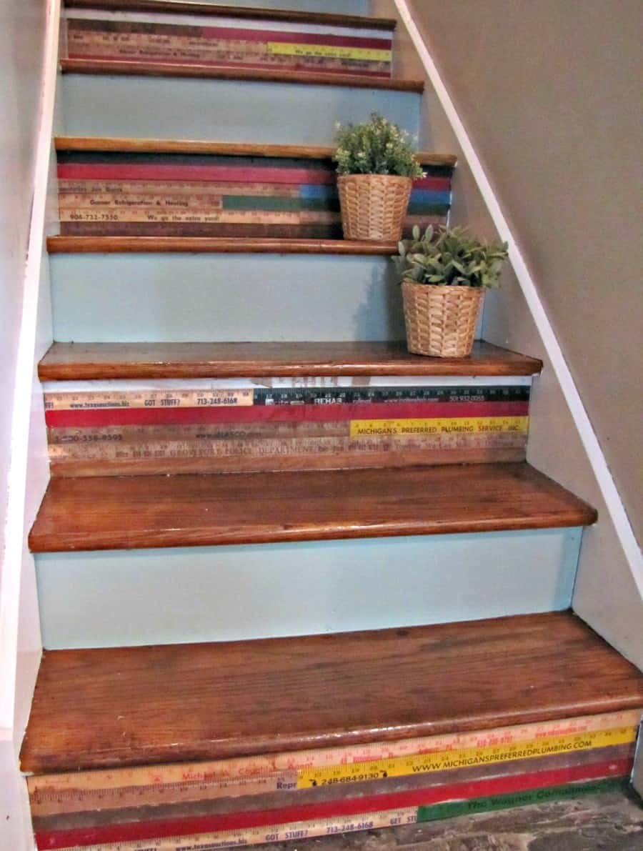 Multi-colored rulers and yard sticks add a rustic feel to any set of stairs.