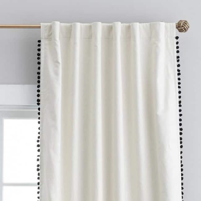 the-emily-meritt-natural-linen-pom-pom-blackout-drape-o