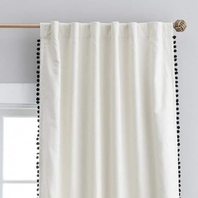 the-emily-meritt-natural-linen-pom-pom-blackout-drape-o
